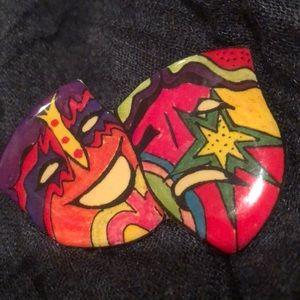 Theater themed acrylic coated pin.